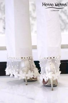 Designer Indian & Pakistani White Embellished Trousers available in Salwar Trousers, Embroidered Trousers and Bootcut trousers. Designed in London UK. Free delivery over White raw silk trousers with flowers and pearl embellishment. ̴Ì_These trouser Salwar Pants, Salwar Designs, Blouse Designs, Pants For Women, Clothes For Women, Trousers Women, Pakistani Outfits, Pakistani Girl, Trouser Pants