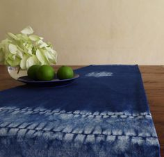 Hand-dyed with natural indigo. Unique stitch resist design on cotton hand-weave. Backed with plain white cotton.  150 x 32cm