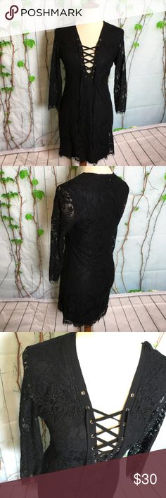 NW/T Forever 21 Lace-up Black Lace Dress Size M. Good for a size S as well.   Make a reasonable offer and I'll either counter, accept or decline. No trades.  Please check out the rest of my closet, I have various brands. Forever 21 Dresses Mini