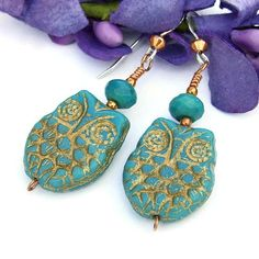 The WHOOO LOVES ME? handmade owl earrings are . . . well . . . a real hoot!  Artisan designed, the stylish earrings feature Czech glass owls in a beautiful turquoise blue color with a metallic gold Pi