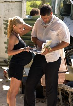 """1.04 """"Walkabout"""" – Publicity still. Claire shows Jack some of the personal items that have been found in the wreckage. She suggests that maybe he could lead a memorial service, but he's not interested in doing that."""