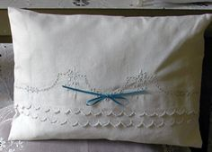Vintage tea towel pillow, cleverly folded with sides sewn together.  No cutting.