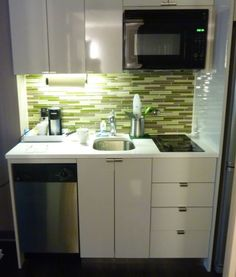 kitchenette with the layout- microwave, dishwasher, sink, and stove; changes materials Small oven instead of microwave