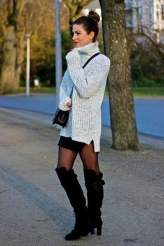 Long loose-fitted sweater and thigh-high boots