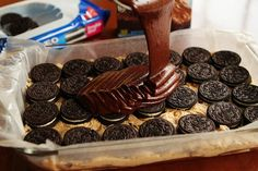 brownie batter ... poured over oreos ... arranged over cookie dough ... also known as Santa's Suicide. Yummy