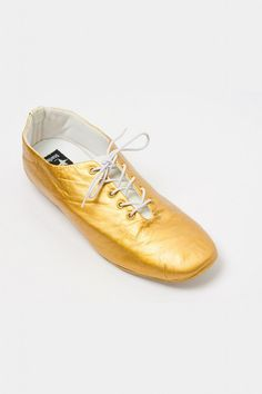 Gold lace up shoes.