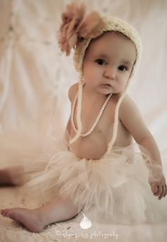Ribbons and pearls and lots of tulle - her favorite things