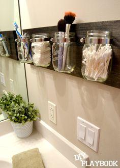 Mason Jars on wood to organize bathroom clutter