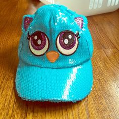 NWT Justice Owl Hat NWT Justice owl hat! Hat has sequins and sparkles, but they won't come off. Perfect for your daughter! Item comes from a smoke free home. Justice Accessories Hats
