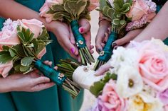 Sorority pins on our bouquets :) definitely doing this!