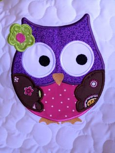 Lime green, pink, brown, and purple baby girl owl quilt.