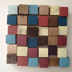 Wall art made from painted reclaimed whisky barrel blocks