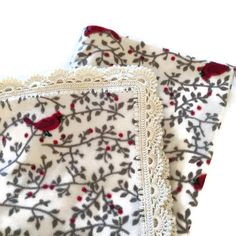 Elegant and Beautiful Cardinal Fleece Blanket with Soft Lace-look Crochet Edge This is the perfect gift for the bird lover in your life This is absolutely GORGEOUS and Super Fun!!! It will make a beautiful and fun gift for that someone that loves birds... maybe even YOU! There