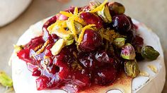 Warm baked brie with cranberry sauce, pistachios, orange zest, and Truvia Nectar. Serve with toasted bread or crackers for a festive cranberry appetizer!