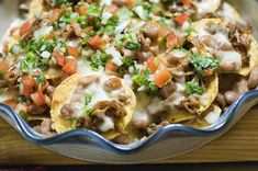 COWBOY NACHOS-from PIONEER WOMAN- she has some of the easiest, simplest, yummiest recipes out there... ♥