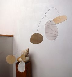 plywood and porcelain mobile by Pukapuka mobiles, via Flickr