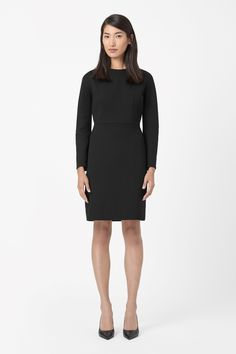 Made from wool-mix twill with a smooth silky lining, this dress has rounded long sleeves for a modern silhouette. Darted at the waistline, it is a fitted style with a round neckline and tonal back zip fastening.