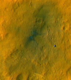 The above image shows a beautiful example of two spectacular robots at work: TheMarsReconnaissanceOrbiter's HiRISE camera captured the Curiosity rover's fresh tracks on Mars