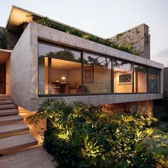 Contemporary garden and architecture in Mexico City by JJRR/ARQUITECTURA. The vegetation around the house is part of the total design, creating a beautiful contrast with the concrete, stone, steel and glass structure. (photo by Nasser Malek) Architecture Design, Residential Architecture, Contemporary Architecture, Contemporary Garden, Contemporary Stairs, German Architecture, Concrete Architecture, Contemporary Building, Contemporary Homes