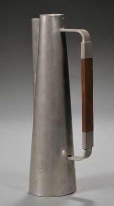 Paul Evans (1931–1987), Pitcher, ca. 1953. Pewter and rosewood. 12 x 4-1/2 x 3-1/2 inches