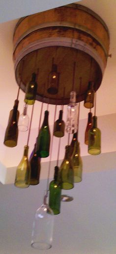 Crafting With Style: Wine Bottle Light Fixtures (Wine Bottle Chandelier) Wine Bottle Art, Lighted Wine Bottles, Bottle Lights, Wine Bottle Crafts, Bottle Bottle, Rustic Light Fixtures, Rustic Lighting, Lighting Ideas, Wine Bottle Chandelier