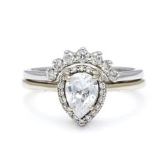 This style but with: Rose gold Champagne stone for pear cut Black stones in tiara band
