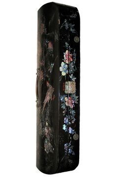 Sumptuously decorated with mother-of-pearl and lacquer during the Meiji period in Japan, this double violin case was presented to the German violinist August Koempel in 1862. An engraved metal plaque inside the lid commemorates the presentation, stating 'Hulde Aan A. Koempel, Dordrecht 1862'.