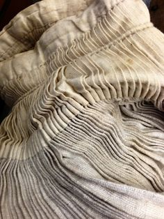 Fabric Manipulation - vintage fabric detail with pleated textures; sewing; textiles