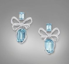 Lyla's Bow earrings crafted in 18K white gold Diamonds GVS x166 = 1.458 carats Emerald cut Brazilian Aquamarines Total carat weight = 15. 893