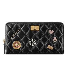 fc09eeba76d2 Chanel 2016 Black Casino Lucky Charms Distressed Calfskin Reissue Wallet  Purse. 1stdibs.com