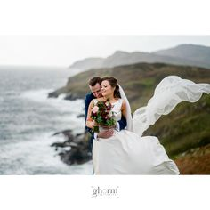 C&S looking across at Sliabh Liag on their wedding day. They braved storm Calum to get the photos taken beside Muckross Head, Kilcar, Co Donegal. The bride and groom had their wedding reception in the Mill Park Hotel, Donegal Tow. Photo by Paul McGinty from Ghorm Studio Photography