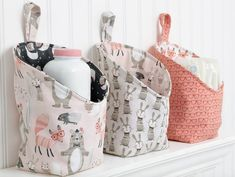 Check out this cute storage pods free sewing pattern and tutorial. You will sure… Check out this cute storage pods free sewing pattern and tutorial. You will surely love this pattern! Sewing Hacks, Sewing Tutorials, Sewing Crafts, Sewing Tips, Tutorial Sewing, Sewing Ideas, Fabric Basket Tutorial, Crafts To Sew, Sewing Designs