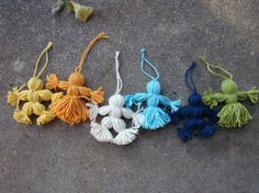 old-fashioned yarn doll tutorial.  A fun way to use of scraps. (even teeny ones for earrings!!)