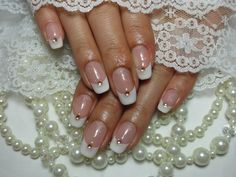 Pink and white bridal french nails with rhinestones