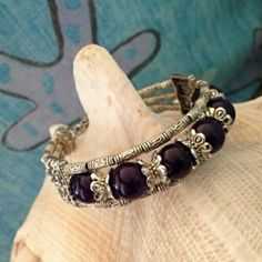 "Tibetan Silver & Amethyst Bangle $10  To place an order, visit our Facebook page ""Moonsong Jewellery"" or email moonsongjewellery@gmail.com"