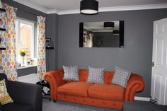 orange and grey living room ideas. Without the orange couch  Modern Living Room with Blood Orange Couch Lovely Rooms