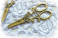 Just Listed!  I just love these sweet, little Antique Bronze plated scissor replicas. They are so wonderful for adding that perfect touch to your scrapbbook, altered art, jewelry making, or craft project.  http://www.reneabouquets.com/#!product/prd1/2595159031/set-of-2-shabby-sweet-metal-scissors
