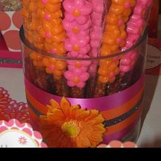 Chocolate daisy pretzels.  Made them for my daughters 1st birthday which was a fuchsia and orange daisy theme.  They sell the molds at party city.