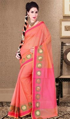 Add grace and charm for your look in this pink and salmon shade cotton silk saree. The stunning self work a substantial attribute of this attire. Upon request we can make round front/back neck and short 6 inches sleeves regular sari blouse also. #TrendyShadesDesignPartyWearSari