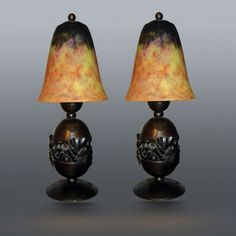 Pair of table lamps by Edgar Brandt and Daum Nancy shades.  France, 1930's    Wrought iron bases decorated with Ginkgo biloba motif and marbelized Daum Nancy glass shades.    Signed.    Dimensions:  height: 31.75 cm (12.5 in.)  diameter: 12.7 cm cm (5 in.)