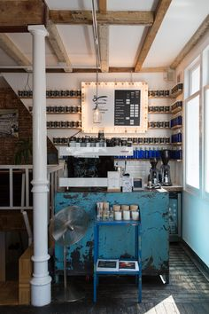 Denham service shop and coffee bar | Amsterdam.