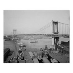 A view of the Manhattan bridge, and the docks along the East River. New York, 1909.