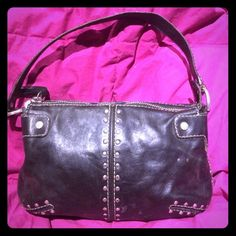 Black leather Mochael Kors purse Cure studded Michael Kors purse. Air it up or wear it down it's the cutest little purse you will have in your wardrobe.  Lightly used but still years left Michael Kors Bags Shoulder Bags
