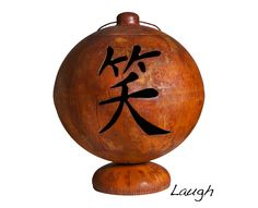"""Asian Inspired Fire Globe™ by Ohio Flame: Live Laugh Love. 37"""" Diameter. $1,599.99"""