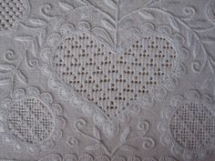 3 of 3 Click though to site page for full dos and don'ts. Heart - with the exception of the top and more upper middle - surrounded by buildings Equally sized and evenly distributed eyelet sheets.  The thread size is correct and the stitches are worked in the correct density.