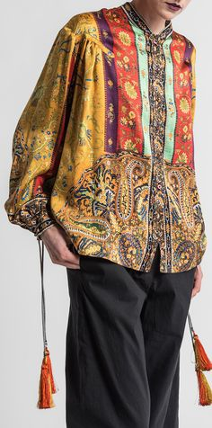 $2,185.00 | Etro Runway Silk Saffron Top in Marigold | Etro Clothing is rich in print and pattern. They have become iconic for their intricate and unique paisley. This silk shirt is uses paisley, with tassels, and has influences of Veronica Etro's travels. Etro is sold online and in-store at Santa Fe Dry Goods in Santa Fe, New Mexico.