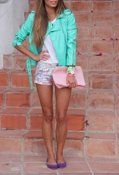 Cute summer outfit. Bright turquoise jacket, white tshirt, floral shorts, pale pink clutch and purple ballet flats
