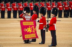 Troops of the Welsh Guards present the Colour standard during Trooping the Colour at Horse Guards Parade in London today (June 13th)