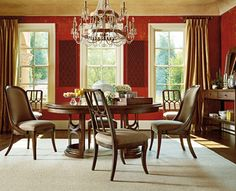 """""""Archipelago"""" round dining table with host chairs"""