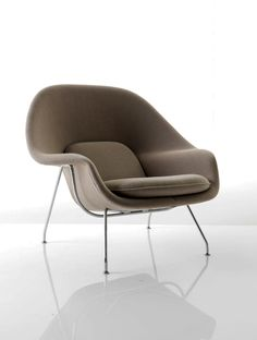 EERO SAARINEN, Womb lounge chair, designed in 1948 for Knoll International. Wool fabric and stainless steel. / Lifestyle Etc.
